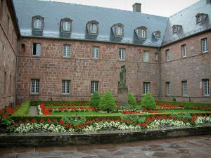 Mount Sainte-Odile - Convent (monastery): cloister garden with flowerbeds, flowers and the Sainte-Odile statue