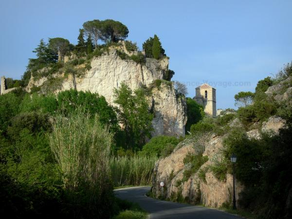 Mourèze rock formations - Rock, church bell tower of the village, trees and road