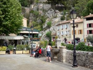 Moustiers-Sainte-Marie - Église square with fountain and lampposts, houses of the village