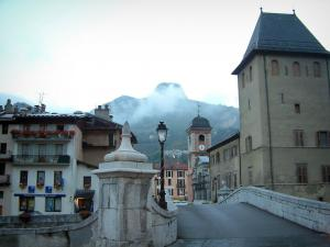 Moûtiers - Bridge with a lamppost, Saint-Pierre cathedral and buildings of the city, mountain in background