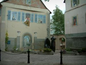 Mulhouse - Small square with art pieces and houses decorated with fake painted facades