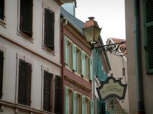 Mulhouse - Houses with pastel colour facades and signboards