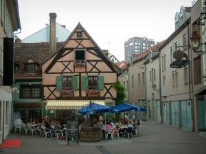 Mulhouse - Café terrace, half-timbered house and buildings