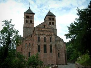 Murbach abbey - Romanesque church with pink sandstone and trees