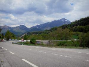 Napoléon road - Bend of the Napoleon road, trees, mountains and cloudy sky