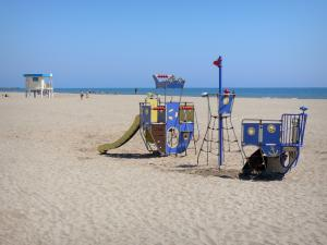 Narbonne-Plage - Playground for kids on the sand beach overlooking the Mediterranean sea