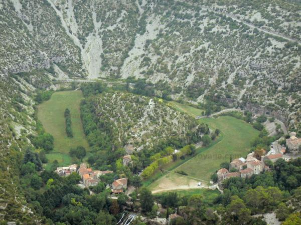 Navacelles cirque - View of the old Vis meander, houses of the village of Navacelles and Navacelles waterfall, in the heart of the natural cirque