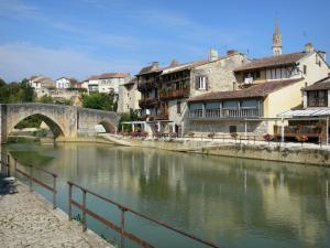 Nérac - Quays, Baïse river, old Bridge, houses of the medieval town and bell tower of the Notre-Dame church overlooking the place, in the Pays d'Albret region