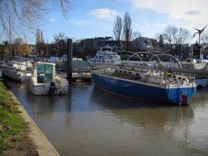 Neuilly-sur-Marne - The River Marne with boats, trees and houses