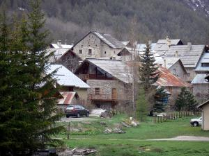 Névache - Houses of the village and trees; in the Clarée valley