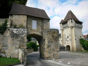 Nevers - Porte du Croux gate (medieval tower-gate) and its front door in the foreground