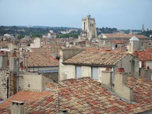 Nîmes - View of the roofs of houses in the old town and bell tower of the Notre-Dame et Saint-Castor cathedral