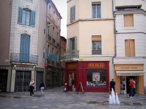 Nîmes - Facades of houses, fountains and shops in the old town
