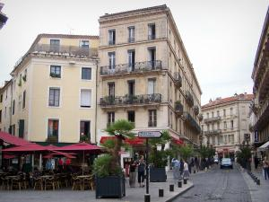 Nîmes - Buildings, café terrace and potted palms in the town