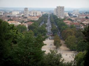 Nîmes - From the Fontaine garden, view of the houses, buildings and lines of trees in the town