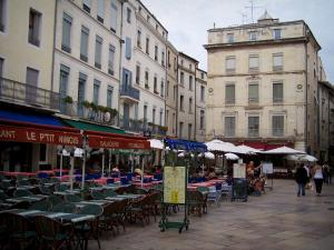 Nîmes - Market square: restaurant terraces and facades of buildings