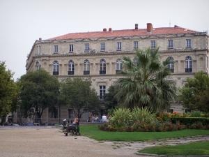 Nîmes - Park with flowers and building in the town