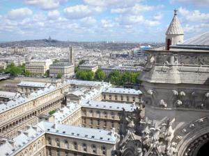 Notre-Dame de Paris cathedral - Panoramic view of the city of Paris from the heights of the cathedral