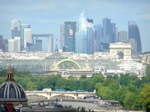 Notre-Dame de Paris cathedral - View of the Seine river, the glass roof of the Great Palace, the Triumphal Arch and the La Défense district from the heights of the cathedral