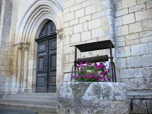 Nouaillé-Maupertuis abbey - Saint-Junien abbey (ancient Benedictine abbey): portal of the abbey church and flower-bedecked well
