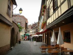 Obernai - Pedestrian street with flower-decked houses and cafe terraces