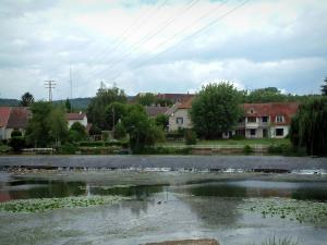 Ognon valley - Ognon river with water lilies, trees and houses