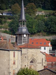 Olliergues - Wooden bell tower of the Notre Dame topped with a lantern and houses of the village; in the Livradois-Forez Regional Nature Park