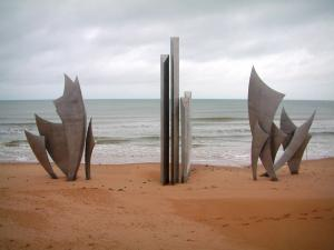 Omaha Beach - Landing site: Omaha beach, commemorative monument, the Channel (sea) and cloudy sky