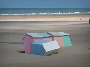 Opal Coast landscapes - Sandy beach with colourful beach huts and the Channel (sea), at Berck-sur-Mer