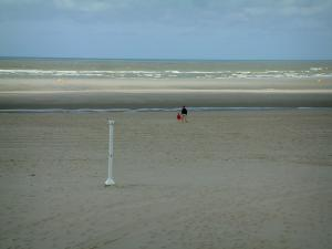 Opal Coast landscapes - Sandy beach with shower, walkers and the Channel (sea), at Touquet-Paris-Plage