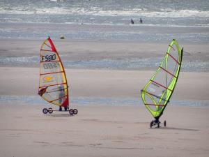 Opal Coast landscapes - Sandy beach with two people speed-sailing (windsurfing boards with wheels) and the Channel (sea), at Hardelot-Plage (Regional Nature Park of Opal Capes and Marshes)