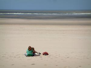 Opal Coast landscapes - Sandy beach with two people and the Channel (sea), at Touquet-Paris-Plage