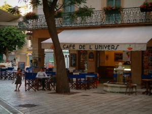 Orange - Square with a café terrace and a small fountain