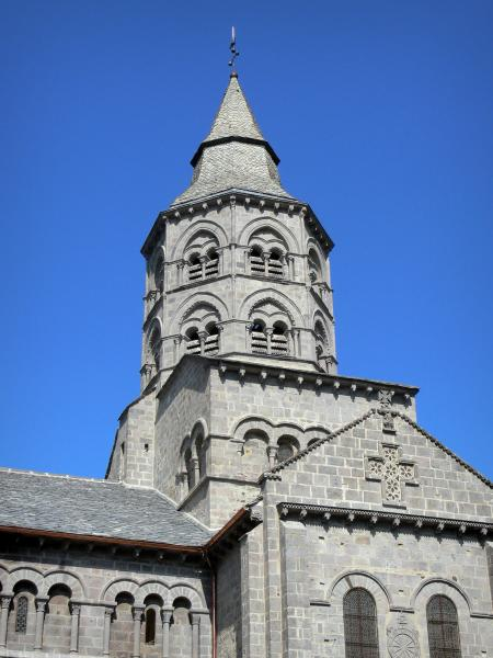 Orcival basilica - Notre-Dame Romanesque basilica and its octagonal tower with two floors; in the Auvergne Volcanic Regional Nature Park in the Massif des Monts Dore