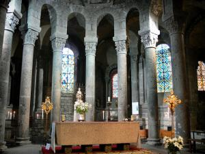 Orcival basilica - Inside of the Notre-Dame Romanesque basilica: choir, granite altar, statue of the Virgin in Majesty, carved capitals and stained glass windows
