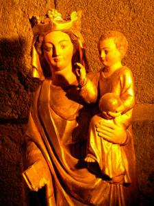 Orcival basilica - Crypt of the Notre-Dame Romanesque basilica: wooden statue of the Virgin and Child