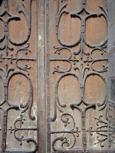 Orcival basilica - Wrought iron hinges of a door of the Romanesque Basilica Notre-Dame