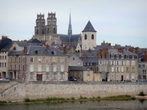 Orléans - Towers of the Sainte-Croix cathedral (Gothic building), bell tower of the Saint-Donatien church, houses and buildings of the city, the Loire River
