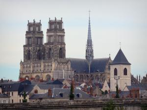 Orléans - Towers of the Sainte-Croix cathedral (Gothic building), bell tower of the Saint-Donatien church, roofs of houses and buildings of the city
