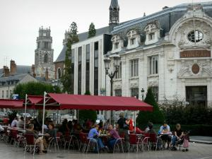 Orléans - Houses and café terrace of the Martroi square, bell tower of the Saint-Pierre-du-Martroi church and the towers of the Sainte-Croix cathedral in background