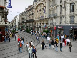 Orléans - République street: buildings, shops and tramway