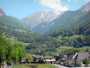 Ossau valley - Houses of the town of Laruns with a view of the Pyrenees mountains; in Béarn