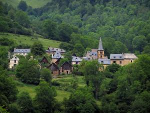 Oueil valley - Church, houses of a mountain village, and trees, in the Pyrenees