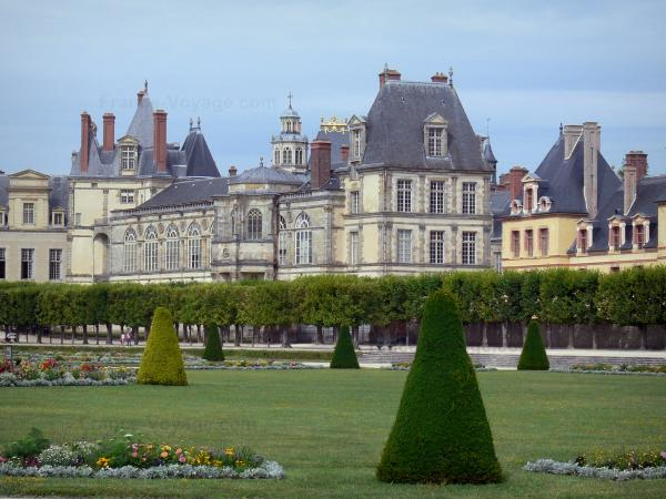 Palace of Fontainebleau - Palace of Fontainebleau and large flowerbed of the French-style formal garden