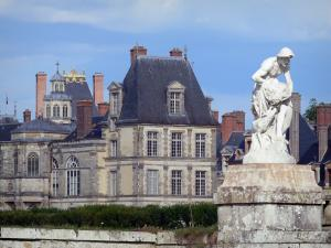 Palace of Fontainebleau - Statue (sculpture) in the foreground and Palace of Fontainebleau