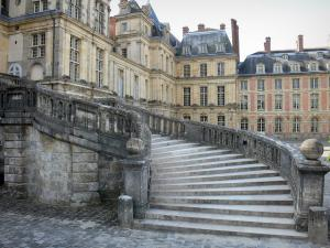 Palace of Fontainebleau - Horseshoe staircase in the White Horse courtyard (Farewell courtyard) and facade of the Palace of Fontainebleau