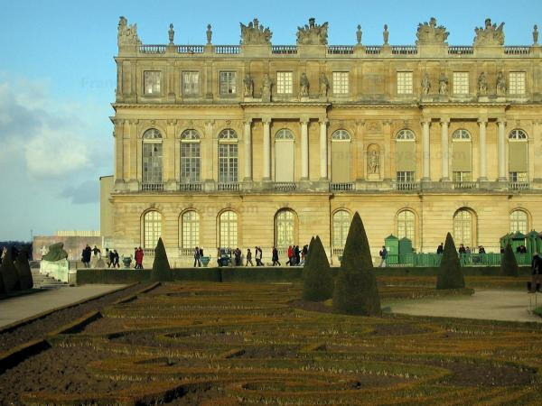 Palace of Versailles - Facade of the castle and Midi flowerbed (park of the castle)
