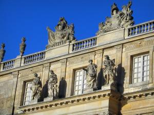 Palace of Versailles - Facade of the castle decorated with sculptures