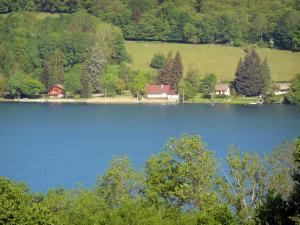 Paladru lake - Natural lake of glacial origin, houses along the water, grassland and trees