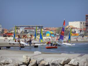 Palavas-les-Flots - Catamarans (sailing school), cliffs, Mediterranean Sea, sandy beach, houses and buildings of the seaside resort